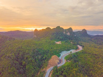 Aerial view of Beautiful road on the mountains in the evening sunset
