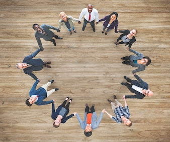 Aerial view of diverse business people holding hands togeher teamwork