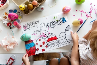 Aerial view of easter holiday painting paper