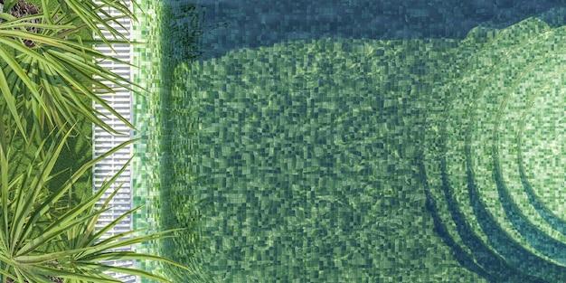 Вид с воздуха на зеленый плиточный бассейн с пальмовыми листьями