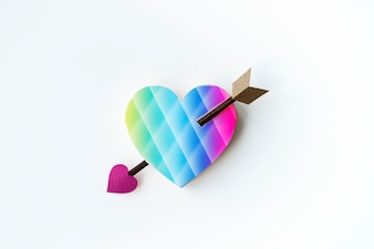 Aerial view of paper craft heart with arrow on white background
