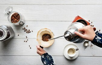 Aerial view of people making drip coffee