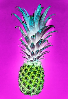 Aerial view of pineapple in negative filter pink background