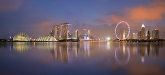 Aerial view of Singapore cityscape with reflection at night