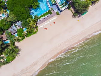 Aerial view of swimming pool with sea and beach