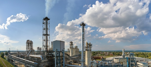 Aerial view of oil and gas refining petrochemical factory with tall refinery plant manufacture structure.
