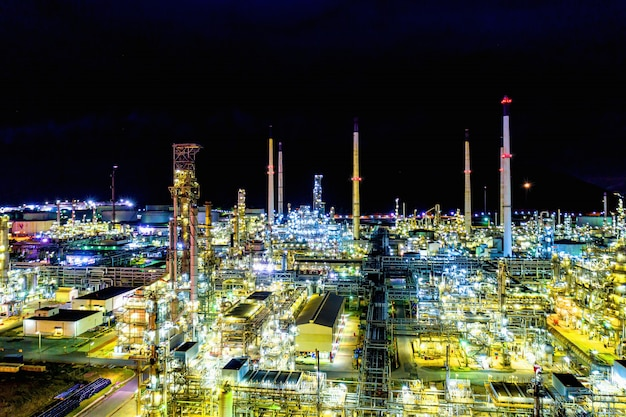 Aerial view. oil refinery factory and oil storage tank at night