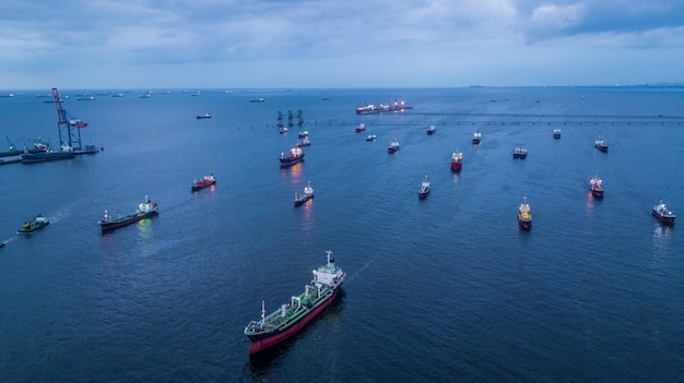 Aerial view oil tanker and gas tanker loading in port in sea at night.