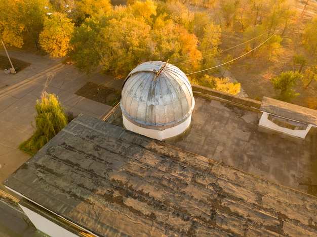 Aerial view of old observatory dome with telescope inside