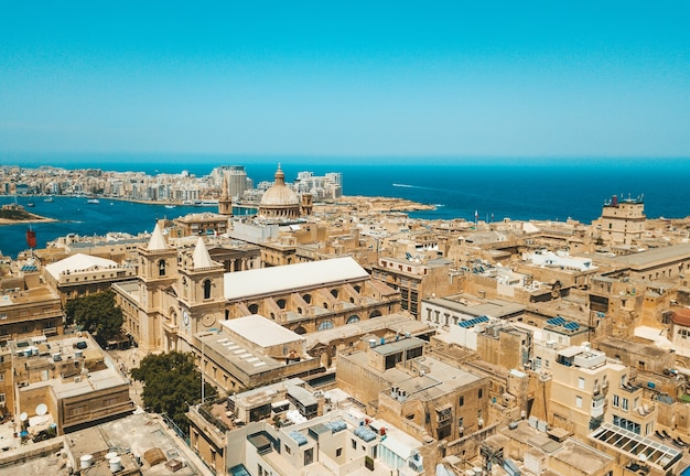 Aerial view of old town buildings near water in valletta, malta