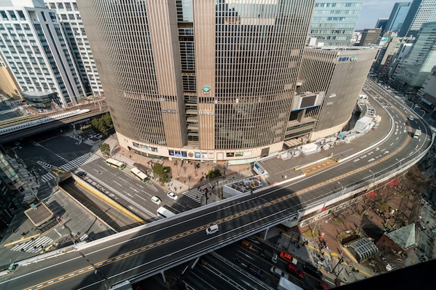 Aerial view of overpass with crowd car and pedestrian crosswalk intersection ginza traffic in tokyo