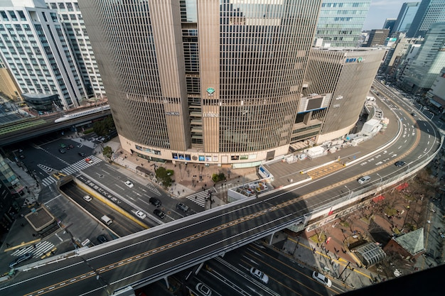 Aerial view of overpass with crowd car and pedestrian crosswalk intersection ginza traffic
