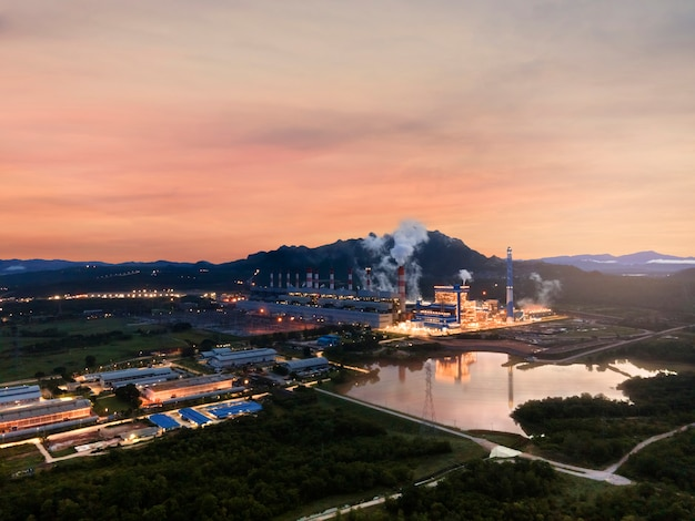 Aerial view, panoramic view of coal-fired power plants in a large area the machine is working to generate electricity. beautiful morning sunrise sky, mae moh, lampang province, thailand.