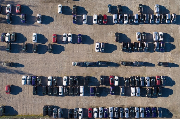 Aerial view of a parking lot with many cars