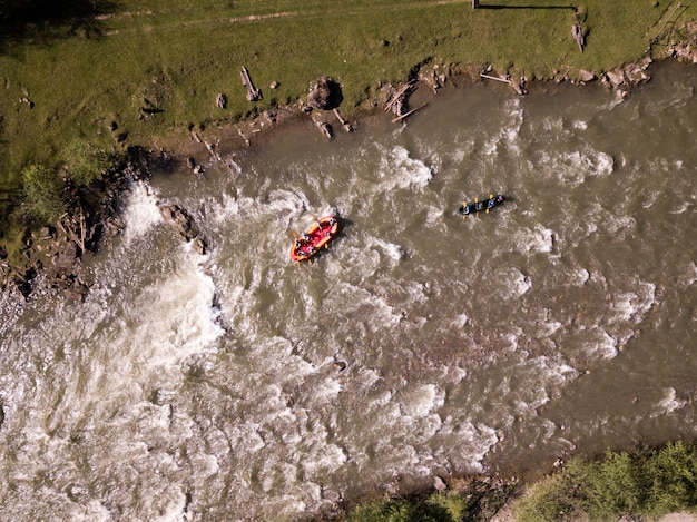 Aerial view of people having fun during rafting in the river