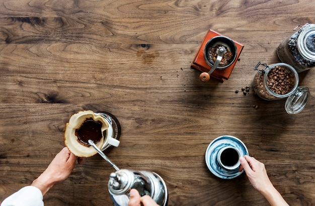 Aerial view of people making drip coffee