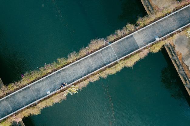 Aerial view of person walking through a bridge