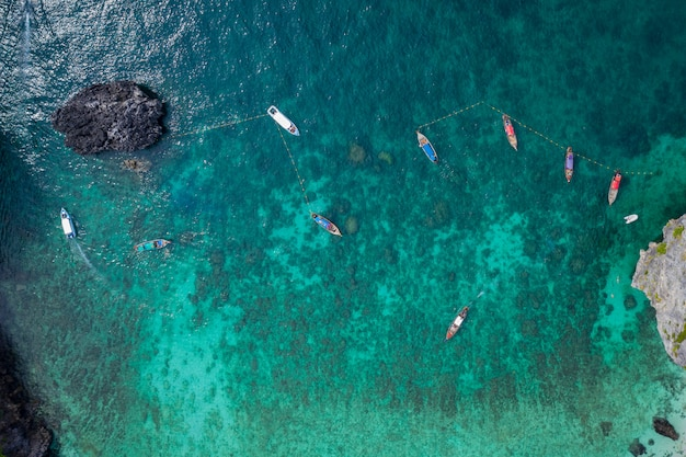 Aerial view phi phi island high season thai and foreign tourists are snorkelling by renting a long tail boat and speed boat for travelling