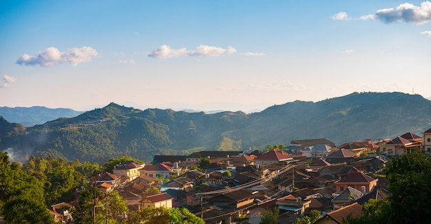 Aerial view of phongsali, north laos near china. yunnan style town on scenic mountain ridge. travel destination for tribal trekking in akha villages. sunset light
