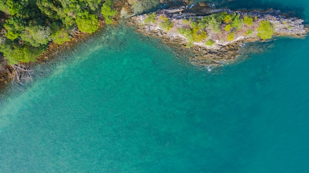 Aerial view photo, tropical beach with ocean and rock on the island