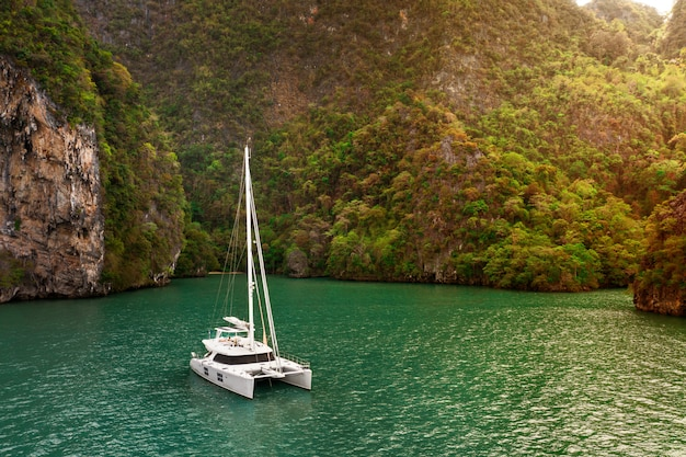 Aerial view of a pleasure sailing yacht in the andaman sea near phi phi islands, thailand