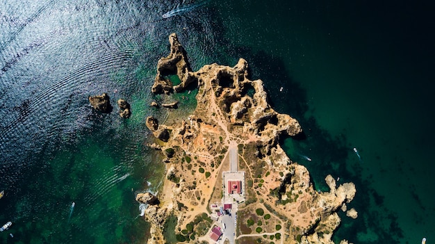 Aerial view of ponta da piedade of lagos, portugal. beauty landscape of rugged seaside cliffs and aqua ocean waters in the algarve region of portugal