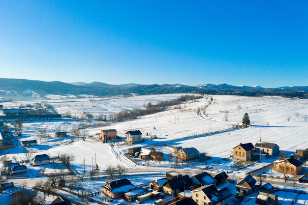 Aerial view over private houses in wintertime