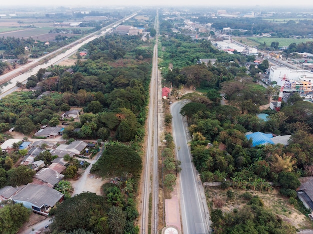 Aerial view of public railway line with trees
