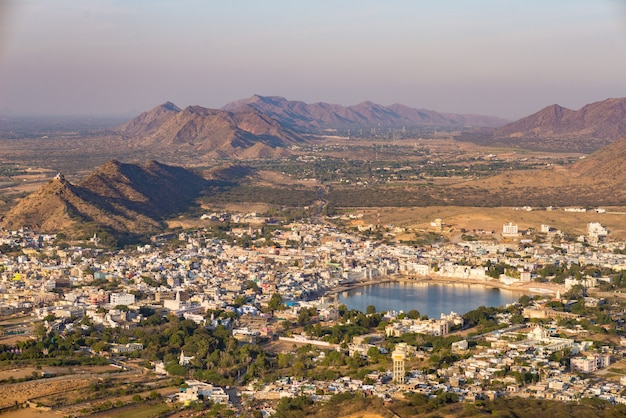 Aerial view of pushkar, the town with the holy lake and the surrounding hills and rural landscape