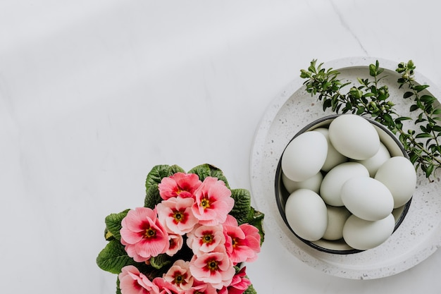 Aerial view of raw eggs on a white marble table