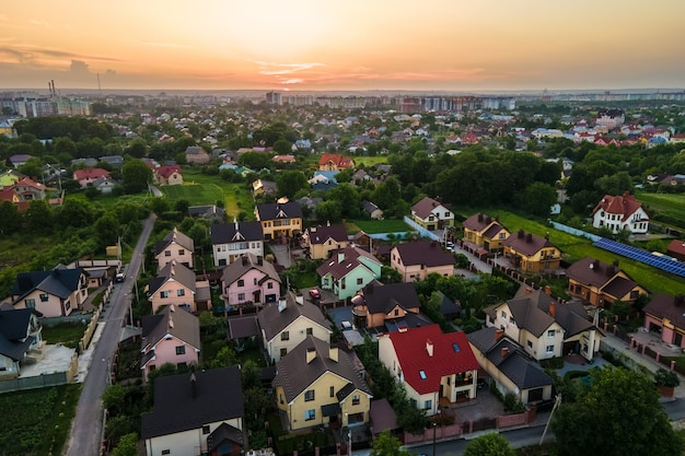 Aerial view of residential houses in suburban rural area at sunset.