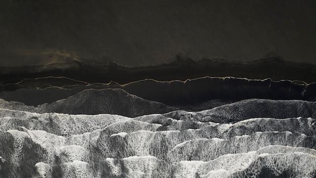 Aerial view of reynisfjara, black sand beach in iceland