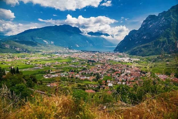 Aerial view of riva del garda valley, mountains and lake garda, trentino, italy