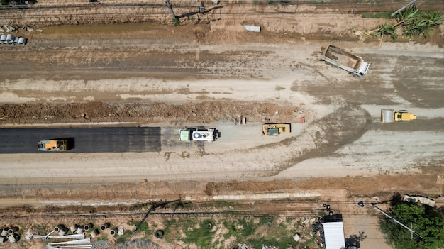 Aerial view above road construction worker view from drone
