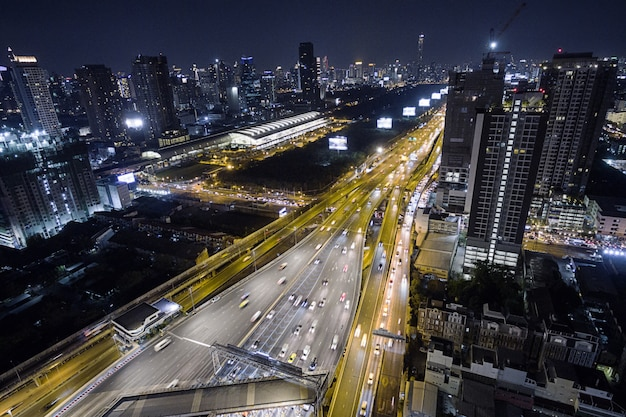 Aerial view road traffic transportation and city in bangkok at night