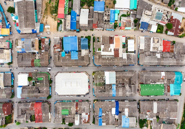 Aerial view of roof residential with traffic road crowded at rural