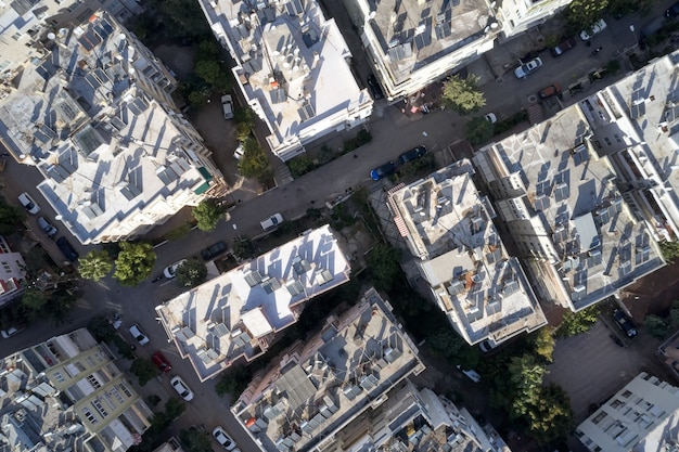 Aerial view of roofs of high-rise buildings with solar panels. drone view of residential multi-storey buildings with solar panels on the roofs.