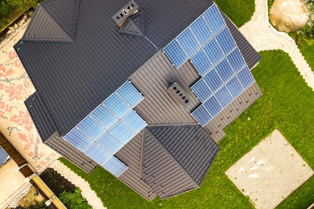 Aerial view of a rural private house with solar photovoltaic panels