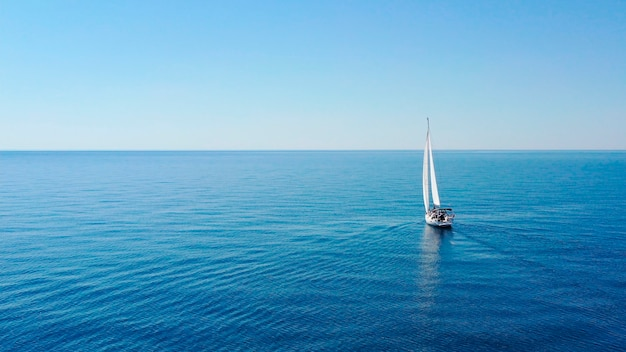 Aerial view of sailing luxury yacht at opened sea at sunny day in croatia