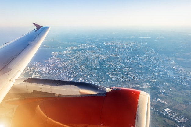 Aerial view of saint-petersburg, russia, from an airplane with wing in front, travel concept.