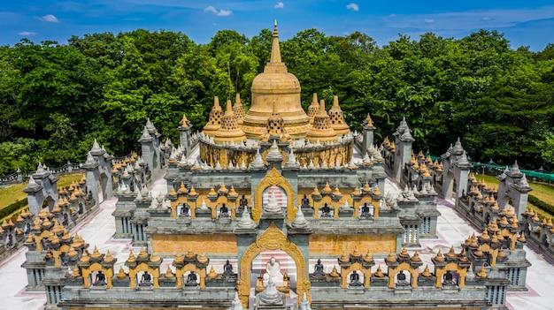 Aerial view sandstone pagoda in wat pa kung temple, wat prachakom wanaram, roi et, thailand.