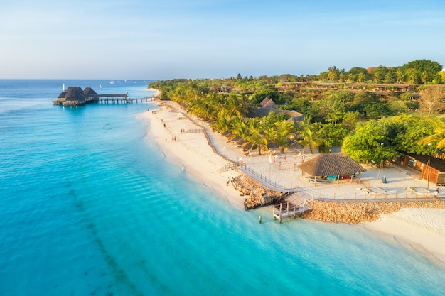 Aerial view of sandy beach of indian ocean at sunset