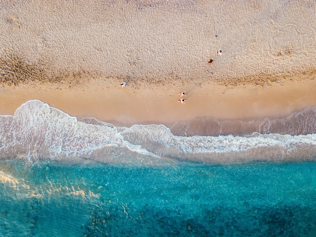 Aerial view of the sandy coast of the turquoise sea