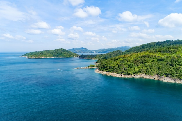 Aerial view on the sea coastline with stones rocks and mountains rainforest. beautiful natural seascape at the summer day time. view on the west coast of the island of phuket island thailand.