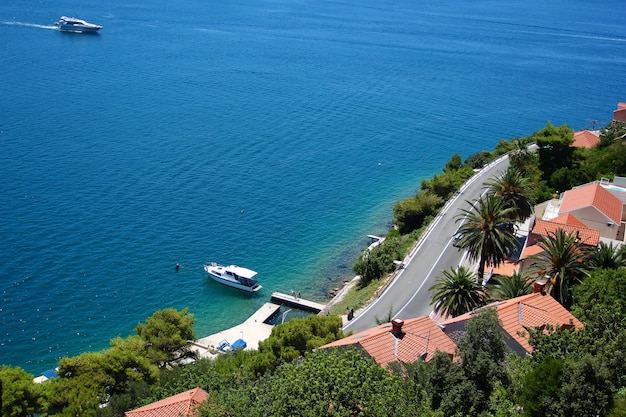 Aerial view on sea coastline with yacht