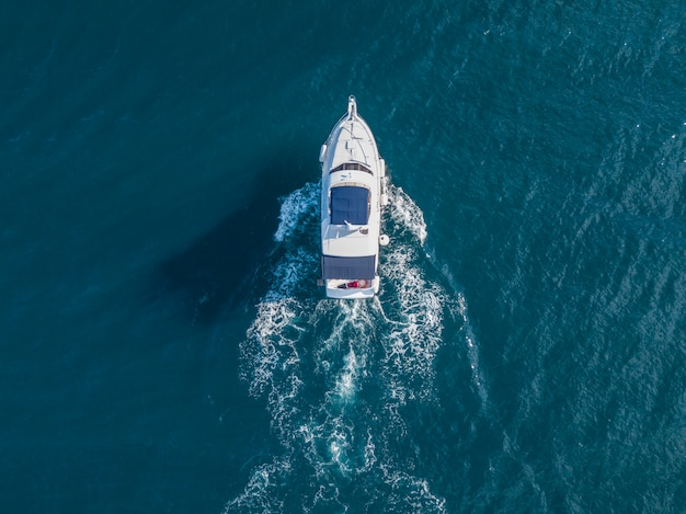 Aerial view of sea emergency service team in fast speed motor boat
