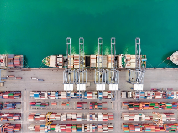 Aerial view of sea freight, cargo ship, cargo container in warehouse harbor at industrial estate thailand