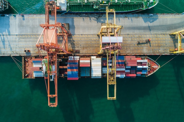 Aerial view sea port container cargo loading ship in import export business logistic
