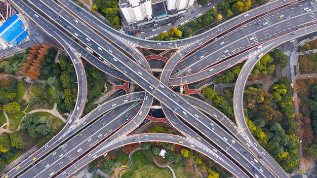 Aerial view shanghai spectacular elevated highway and convergence of roads, bridges, junction and interchange overpass, viaducts in shanghai, transportation and infrastructure development in china.