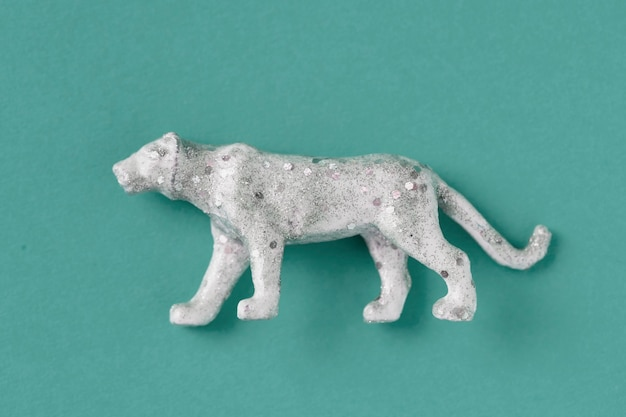 Aerial view of shiny animal figurine tiger with effects